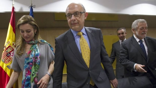 Spanish Finance Minister Cristobal Montoro, centre — seen attending a meeting with budget secretary Marta Fernandez Curras, left, and Public Administration Minister Antonio Beteta — says his country's government 'does not need to be rescued,' even if its banks do.