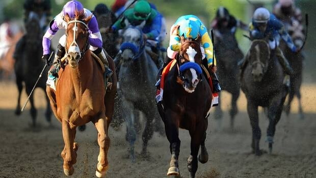 I'll Have Another, ridden by Mario Gutierrez, left, beats Bodemeister, ridden by Mike E. Smith at the finish line to win the 137th running of the Preakness Stakes on Saturday.