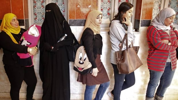 Women queue at a polling station to vote in the second and final round of a referendum on Egypt's new constitution, in Giza, south of Cairo, on Dec. 22, 2012.