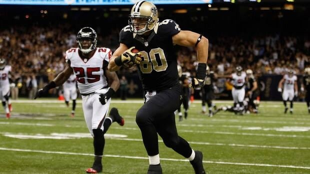 Jimmy Graham, right, of the New Orleans Saints runs past William Moore of the Atlanta Falcons at The Mercedes-Benz Superdome on Sunday in New Orleans, Louisiana.