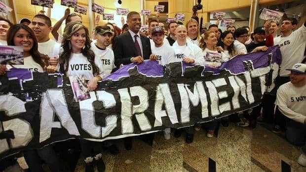 Sacramento Mayor Kevin Johnson posed for a photo with Kings fans after the Sacramento City Council approved a plan to help finance a new $391 sports and entertainment arena, in Sacramento, Calif. Tuesday, March 6, 2012. That plan is now falling apart, leaving Kings fans uncertain once again about their team's future.
