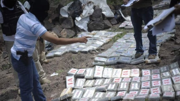 A police officer counts packages containing cocaine during a destruction operation Wednesday on the outskirts of Tegucigalpa, the Honduras capital. More than 450 kilos of cocaine confiscated in different operations were burnt, according to authorities.