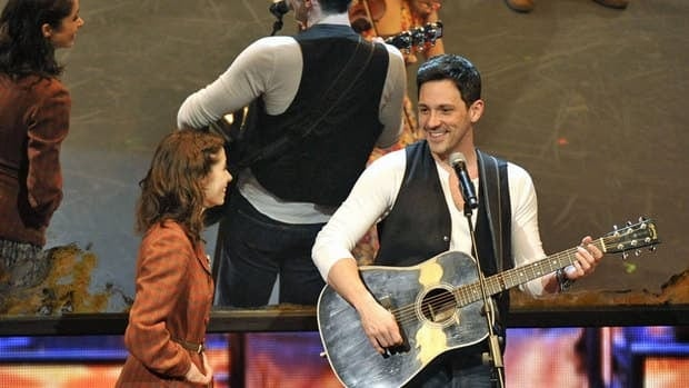 Cristin Milioti, left, and Steve Kazee perform in a scene from Once -- which dominated the 66th Annual Tony Awards in New York on Sunday.