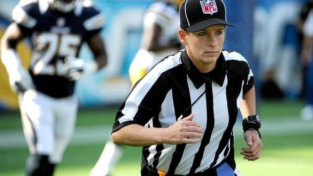 Line judge Shannon Eastin takes the field prior to an NFL preseason football game between the San Diego Chargers and the Green Bay Packers on Thursday. The experienced college official is acting as a replacement while the league and regular refs are in a contract dispute.