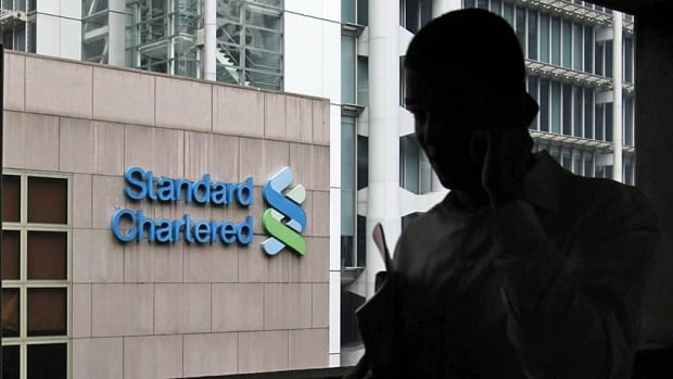 Standard Chartered will pay more than $300 million in fines for laundering money on behalf of four countries that were subject to U.S. economic sanctions from 2001 through 2007.