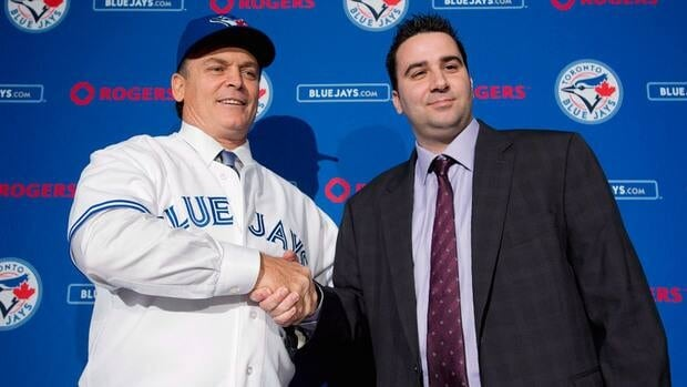 Toronto Blue Jays General Manager Alex Anthopoulos, right, shakes hands with new Blue Jays manager John Gibbons, left, during a press conference in Toronto on Tuesday, Nov. 20, 2012.