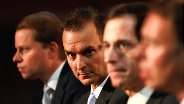 Travis Tygart, facing camera, said in an interview that he's received three death threats.