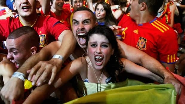 Spanish soccer fans celebrate in Madrid after watching their team defeat Portugal in the European championship semifinal on Wednesday.