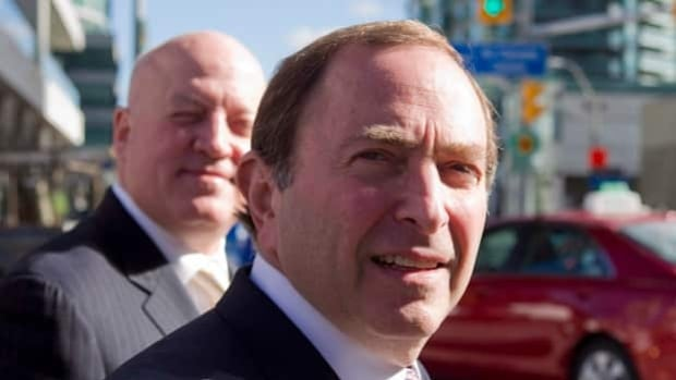 NHL commissioner Gary Bettman, foreground, and deputy commissioner Bill Daly are among the sports league leaders who oppose Bill C-290.