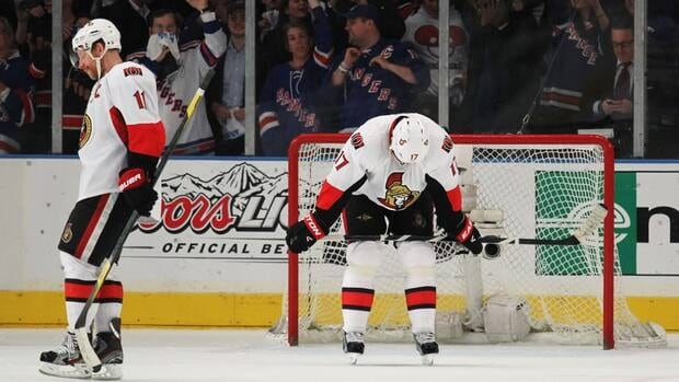 Senators captain Daniel Alfredsson (11) and defenceman Filip Kuba (17) stand dejected after a heart-breaking Game 7 loss to the New York Rangers Thursday night at Madison Square Garden.