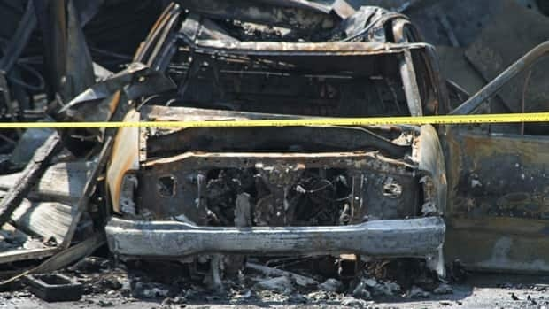 One of the burned out cars that was found backed up next to the building on Main Street East.