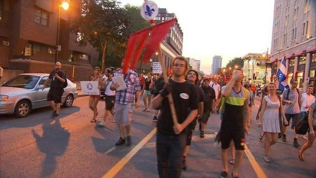 Demonstrators rally in the streets of Montreal and Quebec City to protest against tuition hikes and Bill 78.
