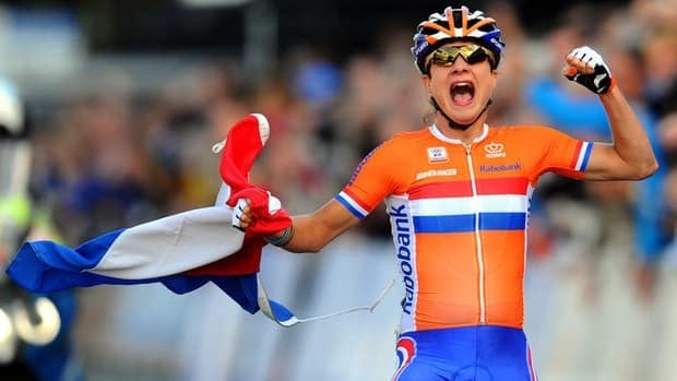 Marianne Vos celebrates as she crosses the finish line.