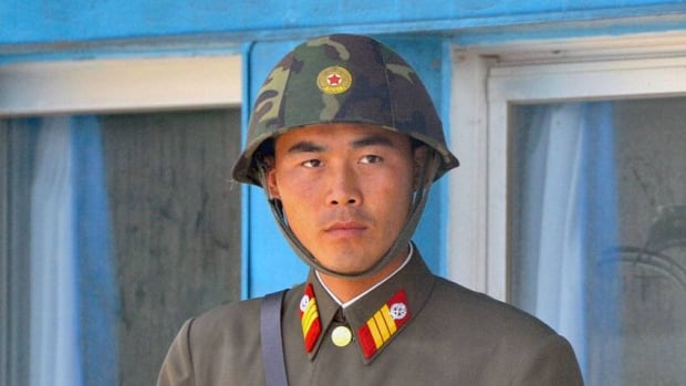 A North Korean soldier stands in Paju, about 55 kilometres north of the South Korean capital of Seoul. Media in the South have criticized ongoing children's festivals in the North.