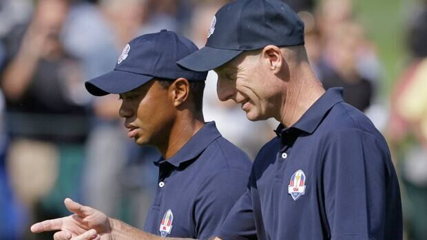 Jim Furyk talks to Tiger Woods during Ryder Cup preparations at the Medinah Country Club in Medinah, Ill., on Tuesday.