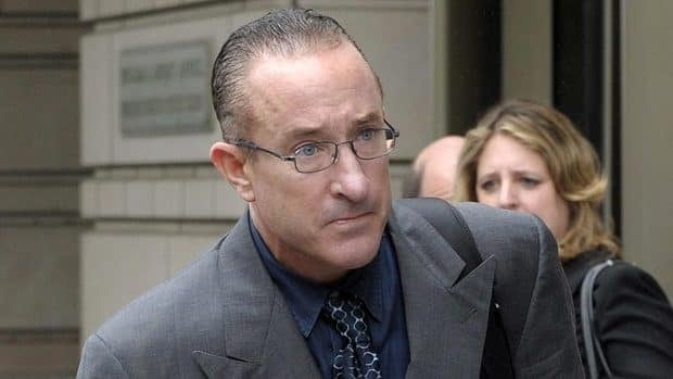 Former Major League baseball trainer Brian McNamee, seen here leaving federal court in Washington on Monday, says he injected Clemens with steroids in 1998, 2000 and 2001 and with human growth hormone in 2000.
