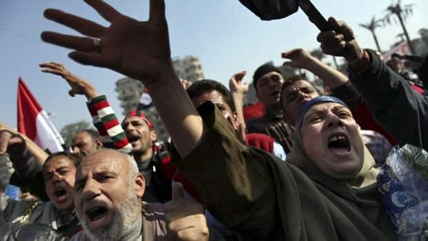 Egyptian protesters chant anti-Muslim Brotherhood slogans during a rally in Cairo's Tahrir Square on Friday.