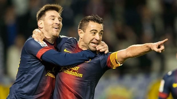 Xavi Hernandez of Barcelona, right, celebrates teammate Lionel Messi after scoring against Real Valladolid at Jose Zorrilla on December 22, 2012 in Valladolid, Spain.
