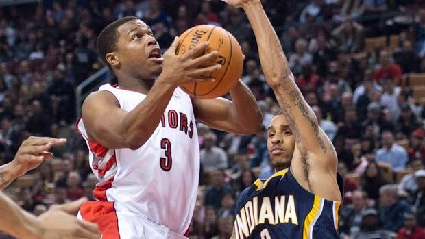 Raptors guard Kyle Lowry, centre, drives to the net past Pacers guard George Hill during first-half action Wednesday at the Air Canada Centre.
