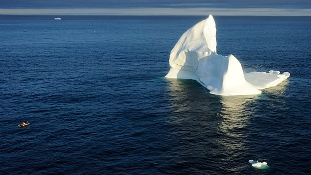 An inflatable boat from the HMCS St. John's inspects a 140-metre high iceberg in the Davis Strait, east of Baffin Island, on August 16 as part of the Canadian military's annual Operation Nanook Arctic sovereignty exercises.
