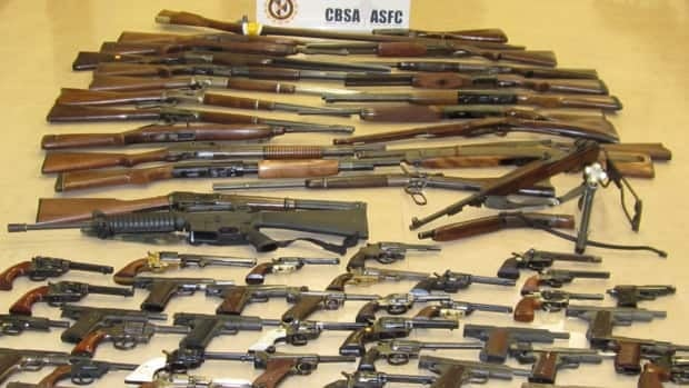 A cache of guns seized at a border crossing in Alberta.