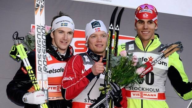 Len Valjas, right, celebrates with winner Eirik Brandsdal, centre, and second place Teodor Peterson during the FIS Cross-Country World Cup in Stockholm, Wednesday March 14, 2012.