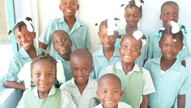 Some of the Hands Across the Sea students returning to school in Haiti in 2012.