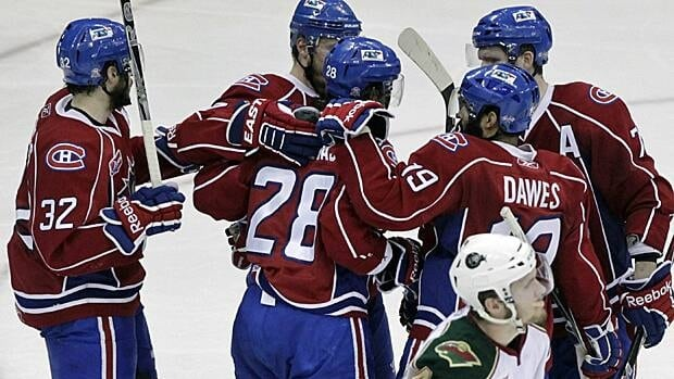 Hamilton Bulldogs players celebrate a goal during a game on May 24, 2011. (Cody Duty/Houston Chronicle/Associated Press)