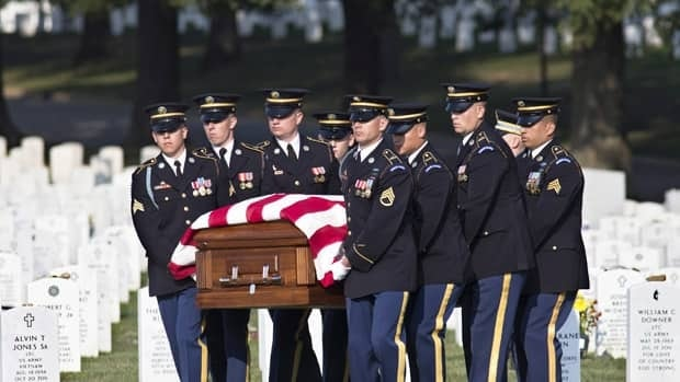 A graveside ceremony for Army Chief Warrant Officer 2 Thalia S. Ramirez, 28, of San Antonio, Texas, is held at Arlington National Cemetery in Arlington, Va. on Wednesday, Sept. 26, 2012.