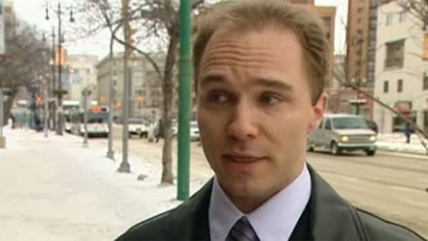 Bradley Jacobson, seen in a 2008 CBC interview, faces 23 charges in connection with an alleged scheme to charge would-be immigrants fees to find non-existent jobs for them in Canada.