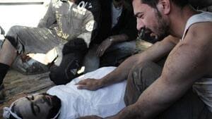 mi-syria-homs-mourn-ap-unco