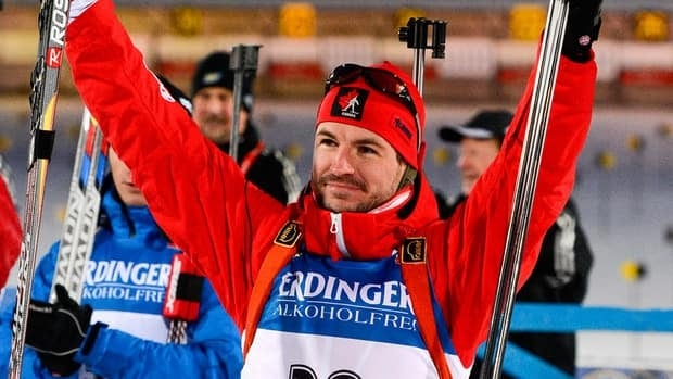 Canada's Jean Philippe Leguellec reacts after winning the event in Ostersund, Sweden, on December 1, 2012.