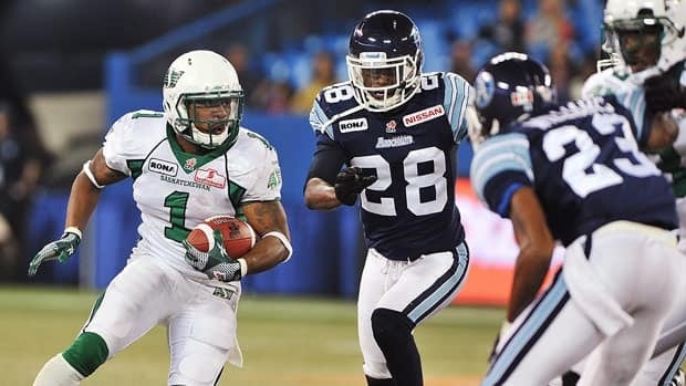 Saskatchewan Roughriders running back Kory Sheets runs the ball against the Argonauts during first half CFL action in Toronto on Monday evening.