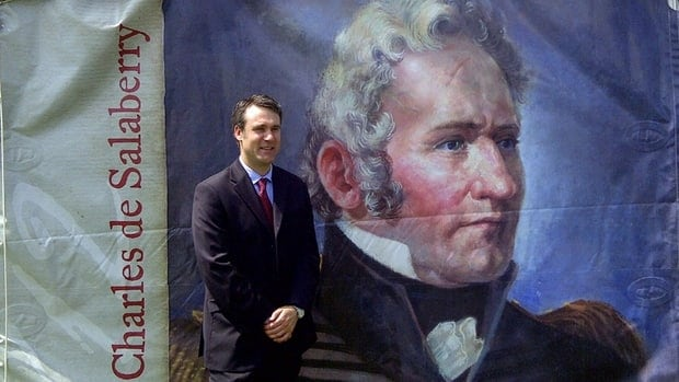 Toronto's Nicolas de Salaberry stands with an image of his ancestor, Charles-Michel de Salaberry, a lieutenant-colonel who led a militia force in the War of 1812.