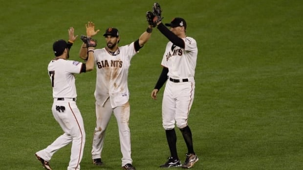 Gregor Blanco, left, Angel Pagan, middle, and Hunter Pence celebrate after the San Francisco Giants defeated the Detroit Tigers, 2-0, in Game 2 of the World Series on Thursday.