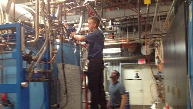 Technicians are at working fixing the cooling system at the Canadian Light Source Synchrotron.