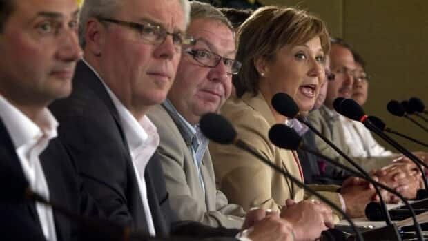 (Right to left) British Columbia Premier Christy Clark addresses a news conference as premiers Darrell Dexter of Nova Scotia, Greg Selinger of Manitoba and Robert Ghiz of P.E.I. look on following a meeting of the Council of the Federation in Vancouver on July 22, 2011. THE CANADIAN PRESS/