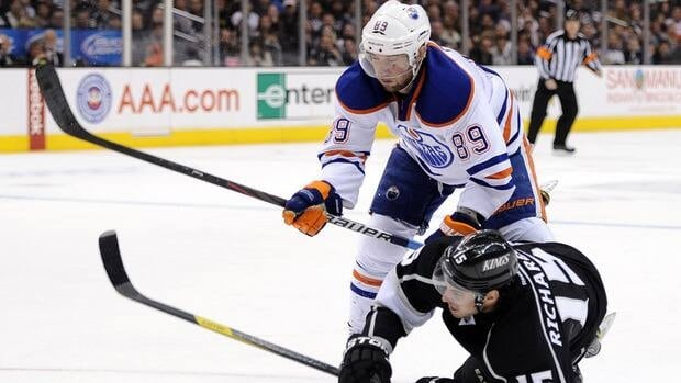 Oilers forward Sam Gagner, top, is one of 16 NHL players electing to go to salary arbitration.