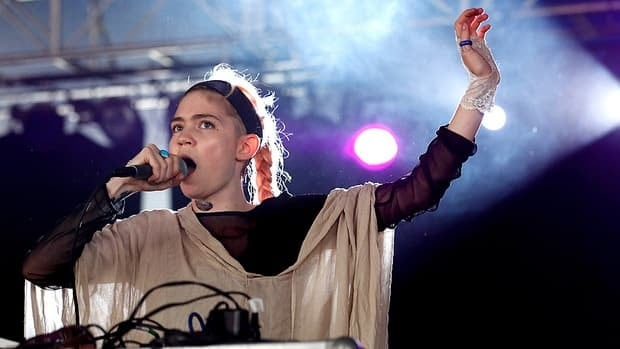 Grimes, seen performing at England's Reading Festival in August, has cancelled a series of upcoming concerts in the U.K. and Europe, citing health issues.