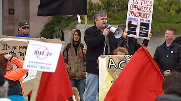 NDP MHA George Murphy addresses a protest against Bill 29 at Confederation Building on Saturday.