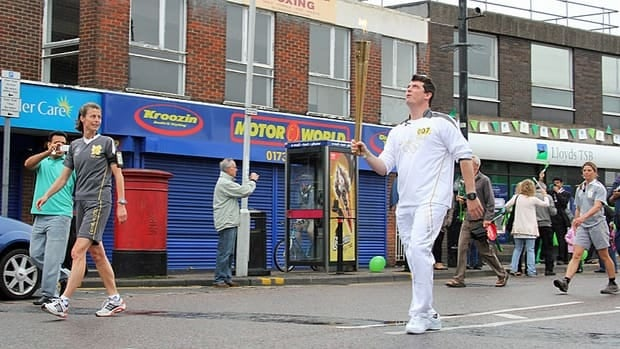 Cassidy Little, who lost a leg to an explosion while serving in Afghanistan in 2011, carried the Olympic torch as the relay passed through Peterborough, UK, on July 4.