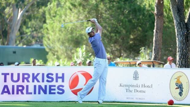 Justin Rose strikes an iron shot from the eighth tee box at Antalya Golf Club on Friday.