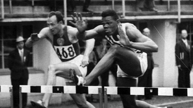 Milt Campbell, right, seen competing at the 1952 Helsinki Olympics, played briefly in the NFL and CFL.