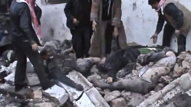 Image taken from video Sunday obtained from the Shaam News Network shows Syrians removing the bodies of those killed from rubble after a government airstrike hit the Hama Suburb of Halfaya, Syria. On Tuesday, rebels took over the town of Harem near the Turkish border.