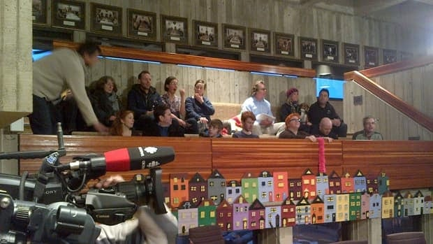 People opposed to a proposed fence on the St. John's waterfront get seated for a St. John's city council meeting.