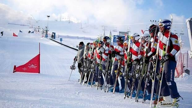 Members of the Canadian ski cross team unveil a special tribute to teammate Nik Zoricic, who died after crashing at a World Cup in 2011, at Canada Olympic Park in Calgary, Alta. on Monday.
