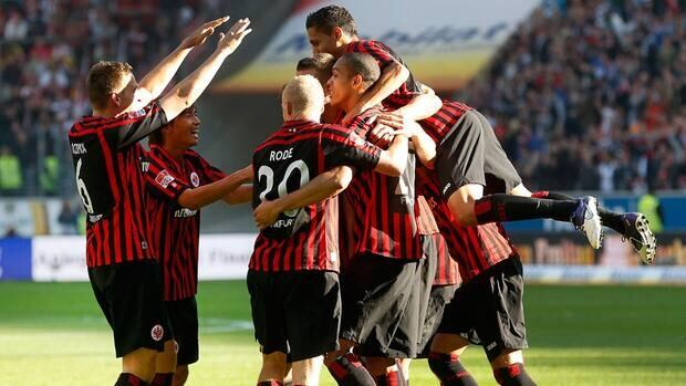 Frankfurt players celebrate their side's second goal during the match between Eintracht Frankfurt and SC Freiburg in Frankfurt, Germany on Sunday.