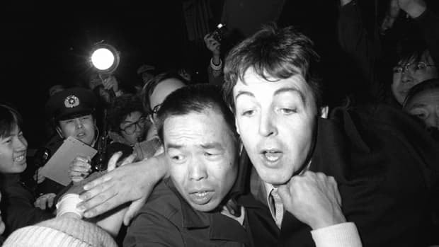 Former Beatles member Paul McCartney, right, is mobbed by fans in Tokyo after his arrest in 1980 for marijuana possession upon arriving in Japan. McCartney told Rolling Stone recently he has quit smoking pot for his daughter, Beatrice.