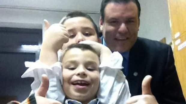 Stephen Watkins poses for a photo with his sons, Christopher and Alexander. Watkins is fighting an international custody battle to bring them back to Canada.