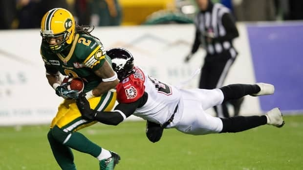 Edmonton Eskimos' Fred Stamps scores a touchdown against the Calgary Stampeders at Commonwealth Stadium in Edmonton on Friday, Nov. 2, 2012.